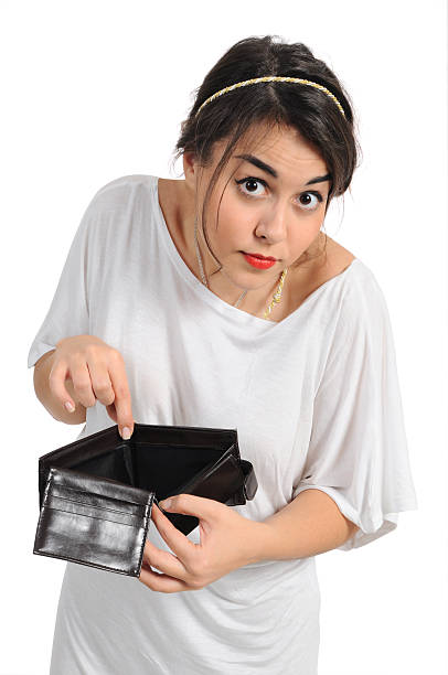 No cash Young woman shows her empty wallet empty wallet stock pictures, royalty-free photos & images