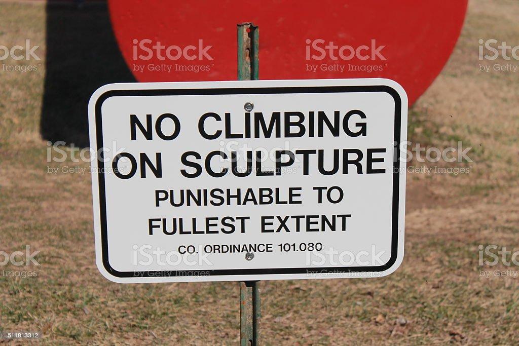 No Climbing on Sculpture Sign stock photo