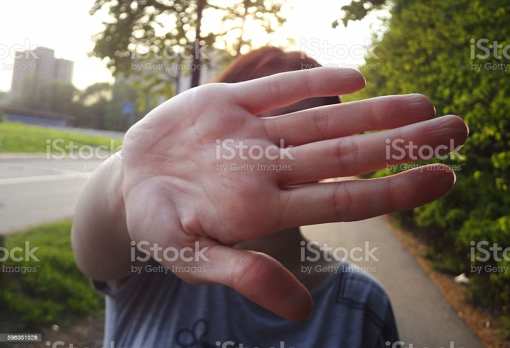 No comments palm covering face of woman stock photo