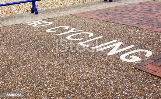 No Cycling instruction painted across a pedestrian pavement in the seaside town of Eastbourne, East Sussex