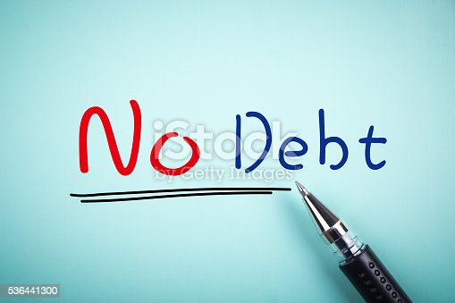 Text No Debt with underline and a ball pen aside.