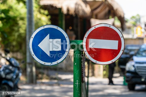 No entry and turn left sign on the street in island Bali, Indonesia, close up