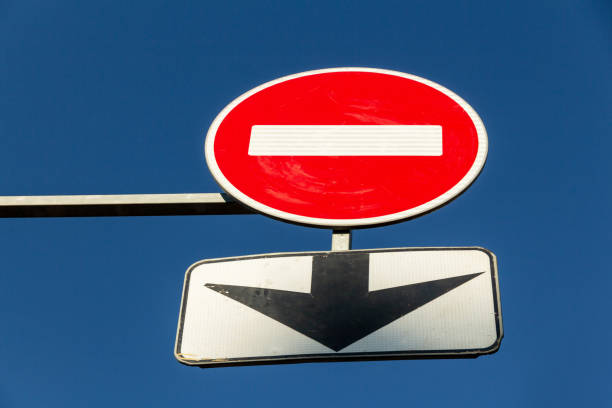 No entry Road sign and black arrow stock photo