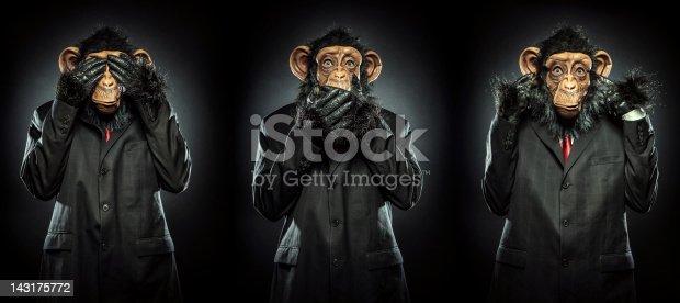 The proverbial Mizaru, Kikazaru, and Iwazaru monkeys, in business suits, motioning