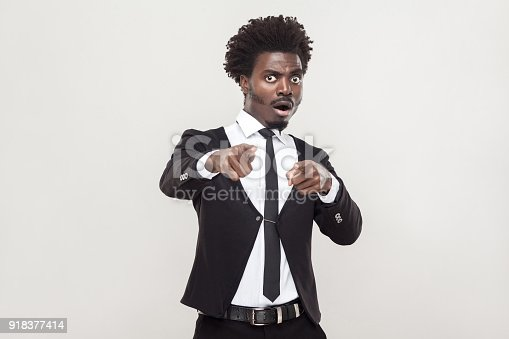 istock No fair! African man pointing fingers and shocked. 918377414