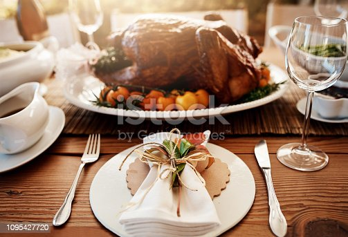 Cropped shot of a roast turkey on a dining table on Thanksgiving