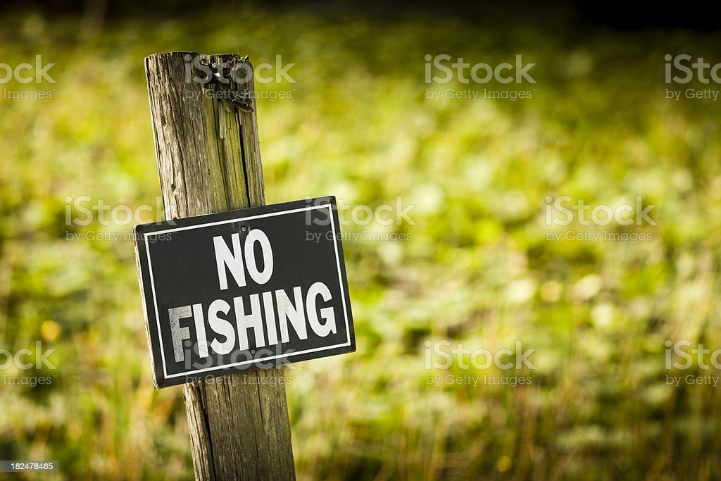No fishing sign on a post stock photo