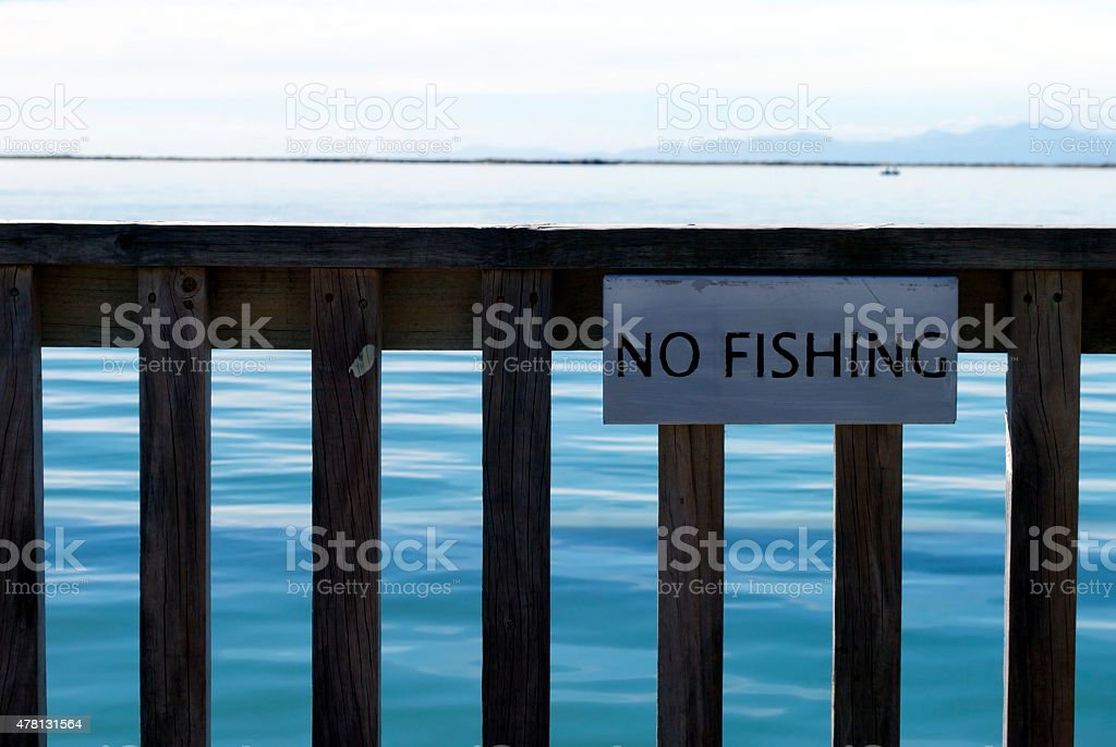 'No Fishing' Sign on Pier stock photo