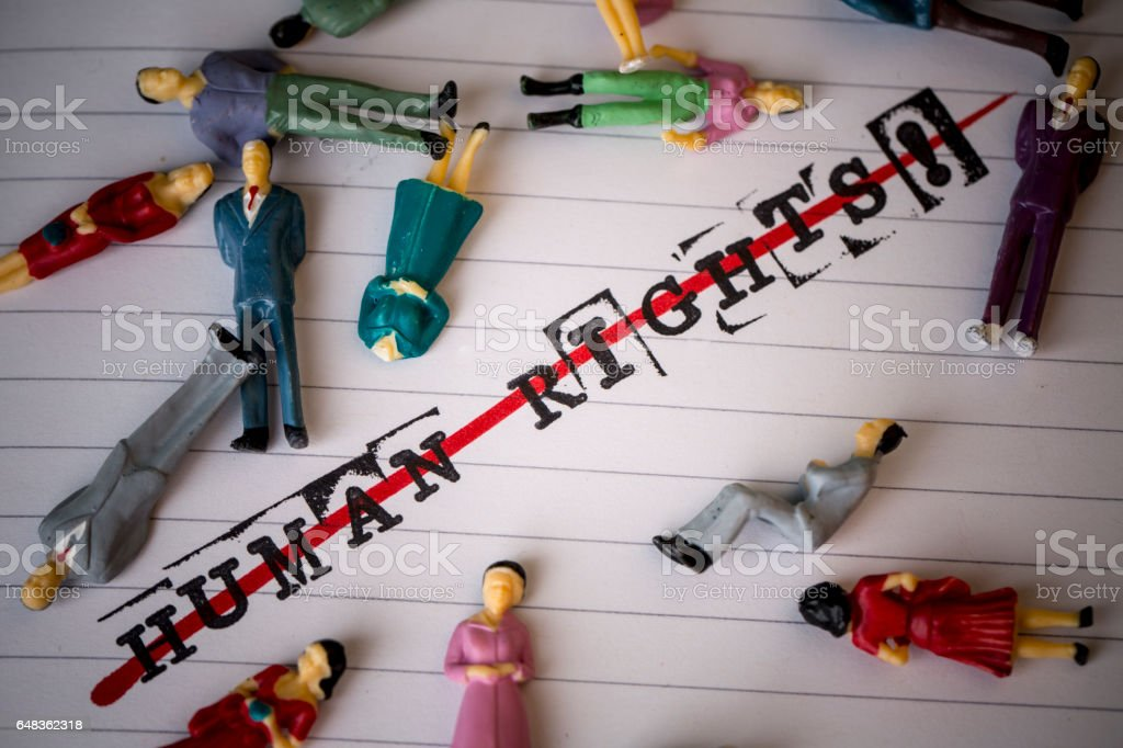 no human rights, strikethrough text on paper stock photo