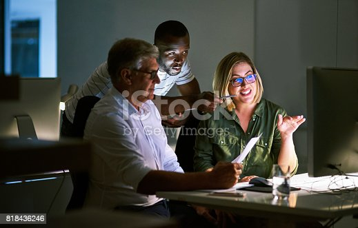 Shot of businesspeople working late in an office