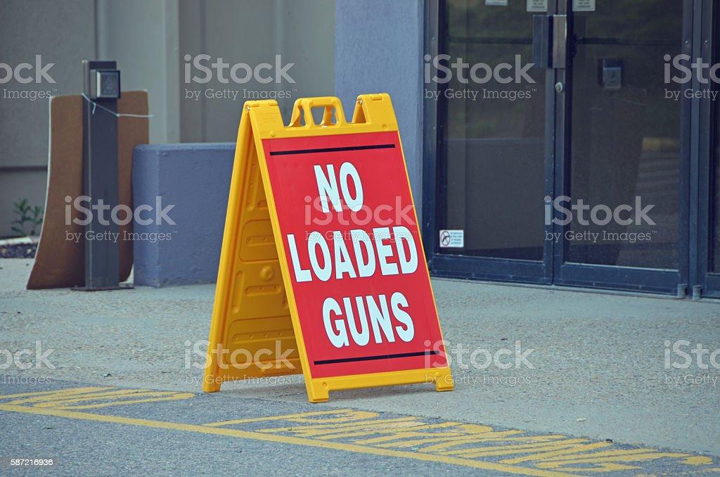 No Loaded Guns Sign stock photo