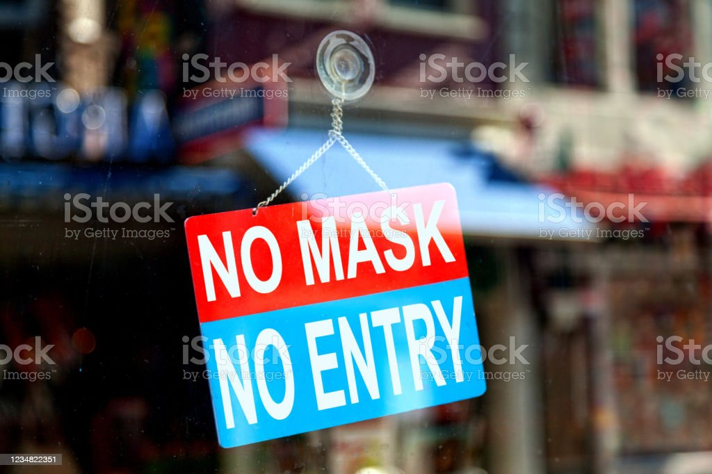 "No mask, no entry - Open sign Red and blue sign in the window of a shop saying ""No mask, no entry"". Bacterium Stock Photo"