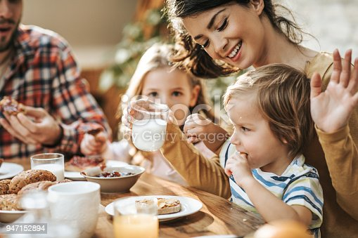 istock No mommy, I don't want to drink yogurt! 947152894