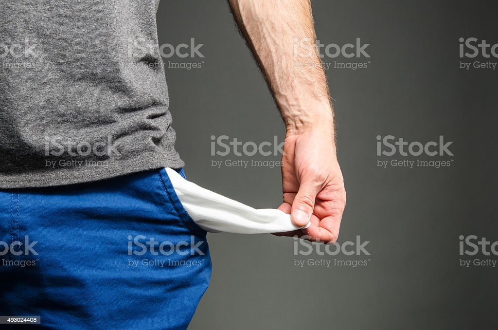 No money image of a male holding out his empty pockets 2015 Stock Photo