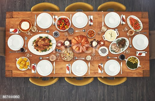Shot of a feast on a dining table with no people at it