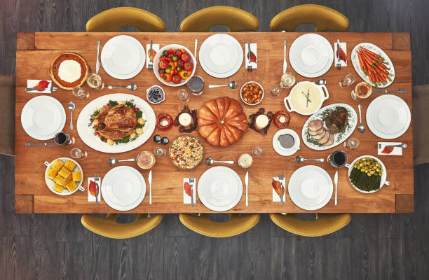 no one can say no to a good meal - dining table stock photos and pictures