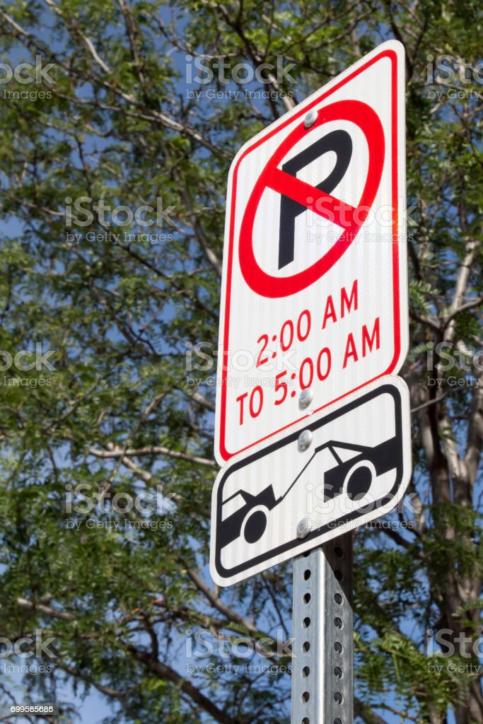 No Parking 2 am to 5 am sign stock photo