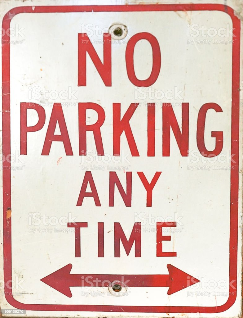 A No Parking Anytime Sign with arrows stock photo