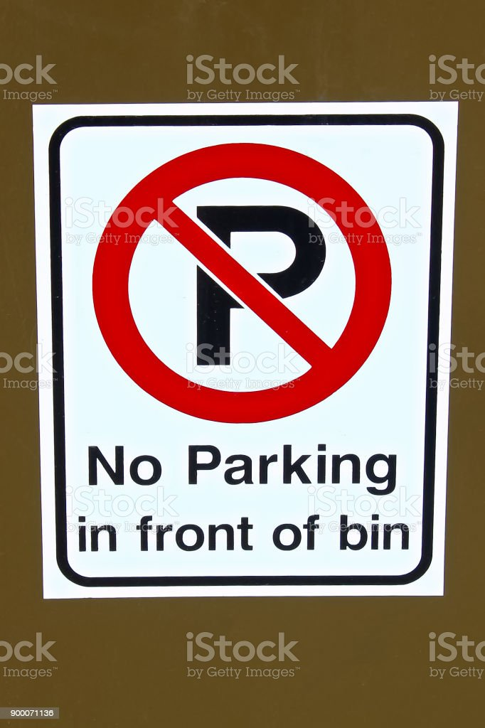 A No Parking In Front Of Garbage Bin Sign Stock Photo More