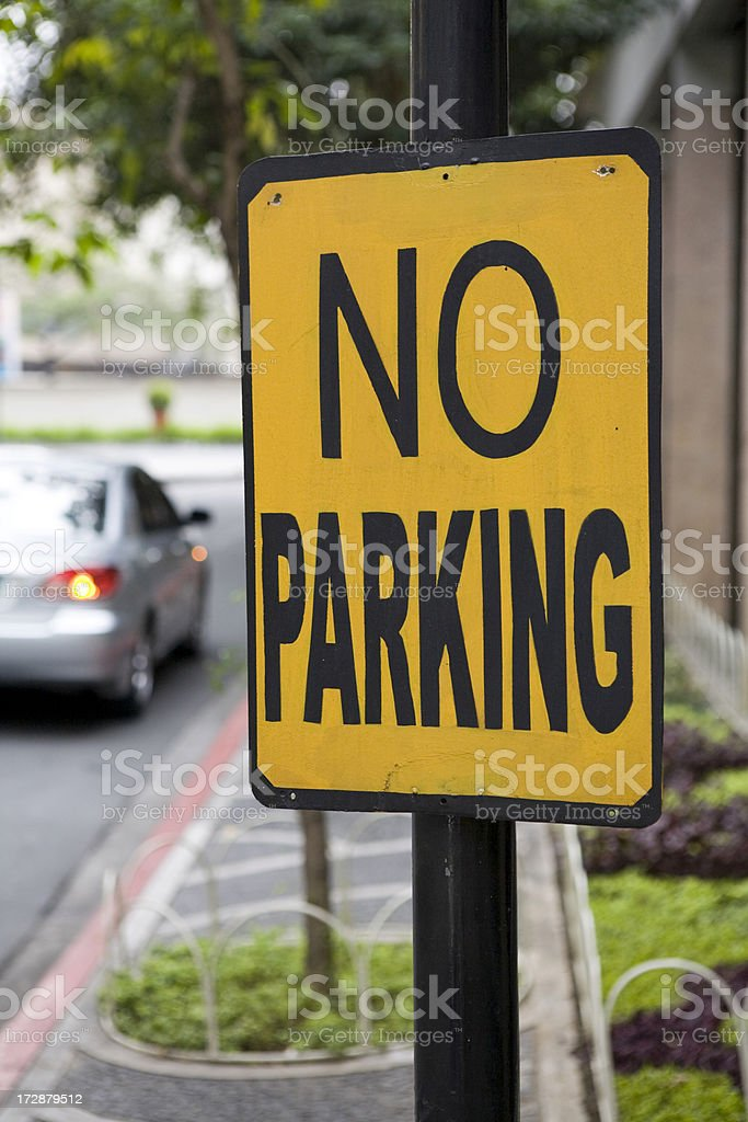 No parking in red zone and illegally parked car stock photo