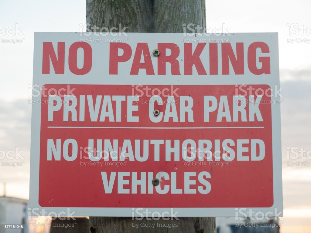 no parking private car park no authorized vehicles sign on post close up stock photo