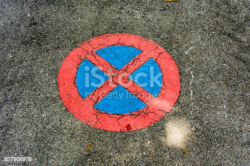 istock no parking sign on concrete 827906978