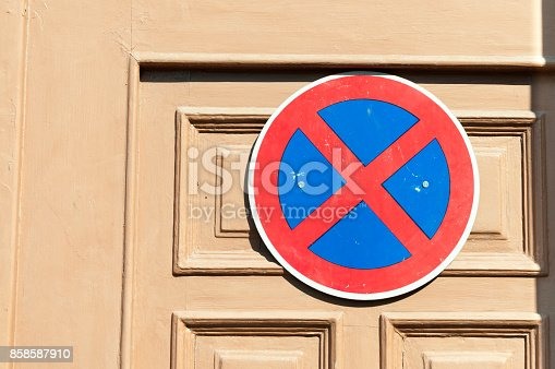 istock No parking sign on the wooden door to protect entrance from the car drivers 858587910