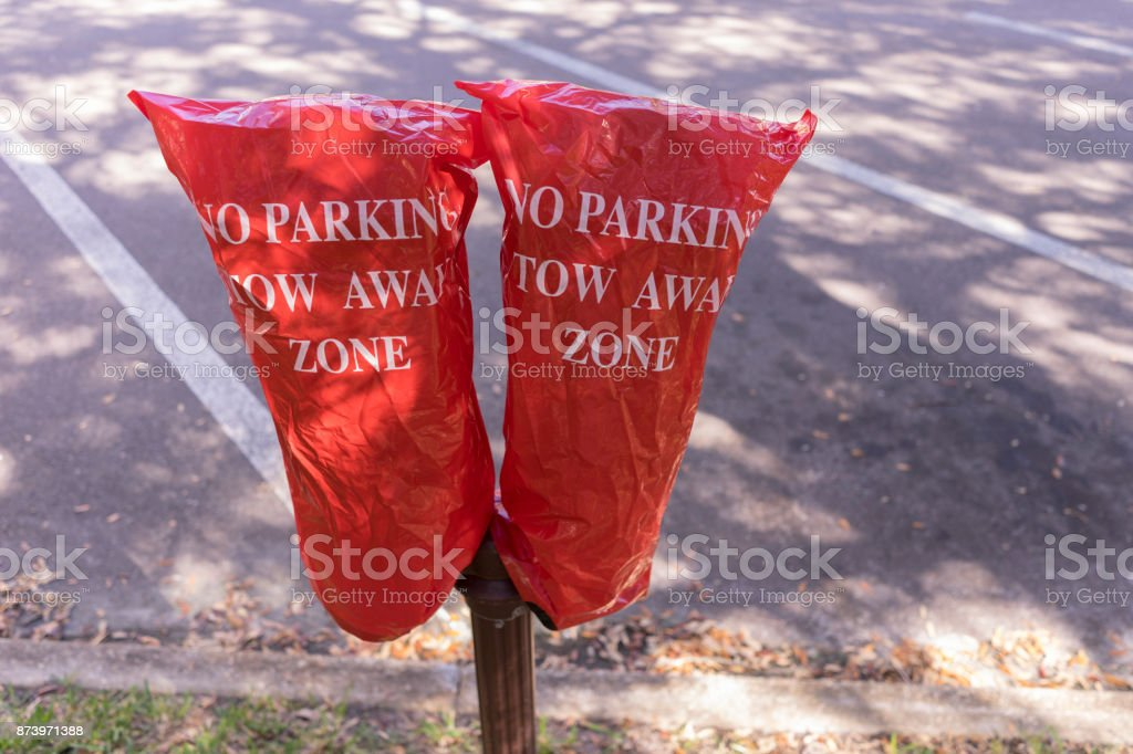 No Parking Tow Away Zone Warning In Red Over A Parking Meter stock photo