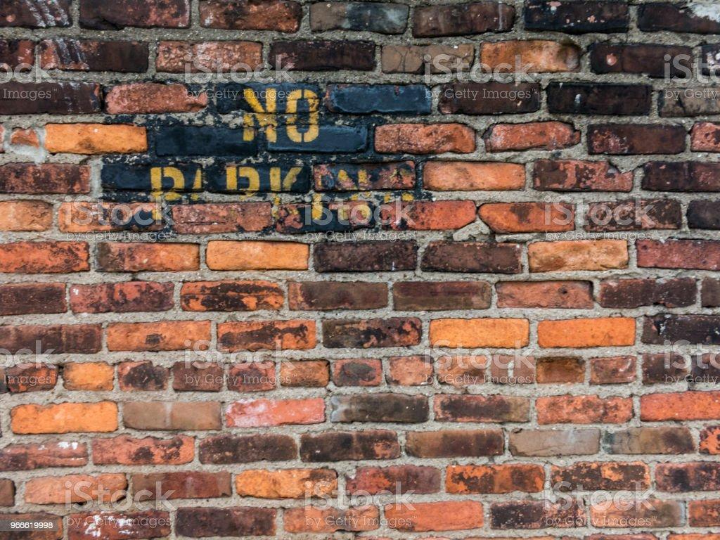 No Parking Urban Brick Wall stock photo