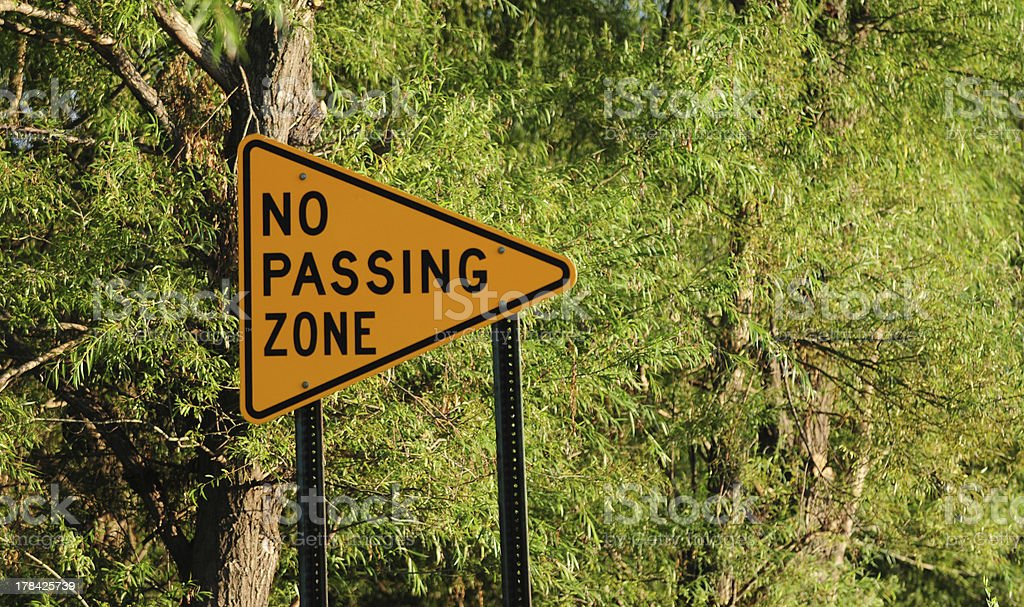 no passing zone sign in nature stock photo