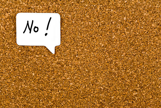 No No with an exclamation mark handwritten in a word balloon. Background of a cork board. single word no stock pictures, royalty-free photos & images