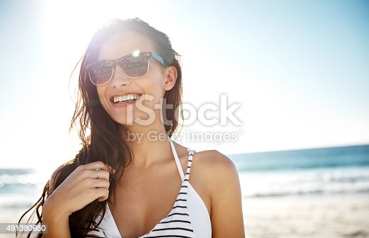 Shot of a young woman enjoying a day at the beachhttp://195.154.178.81/DATA/i_collage/pu/shoots/805663.jpg