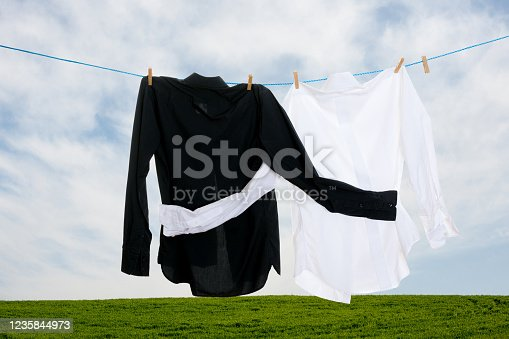 Clean laundry hanging on a clothesline. No racism Concept
