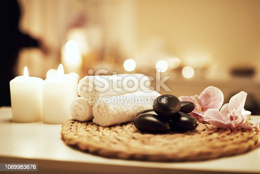 Still life shot of various spa essentials on a table