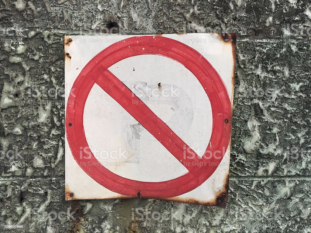 No sign on concrete wall.