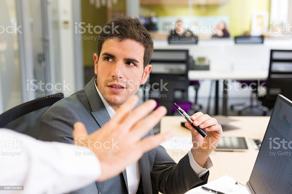 No smoking electronic cigarette in the office stock photo