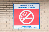 No smoking on hospital grounds sign NHS for patients doctors nurses and visitors fresh air no pollution for a clean environment