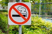 No smoking sign in the park.