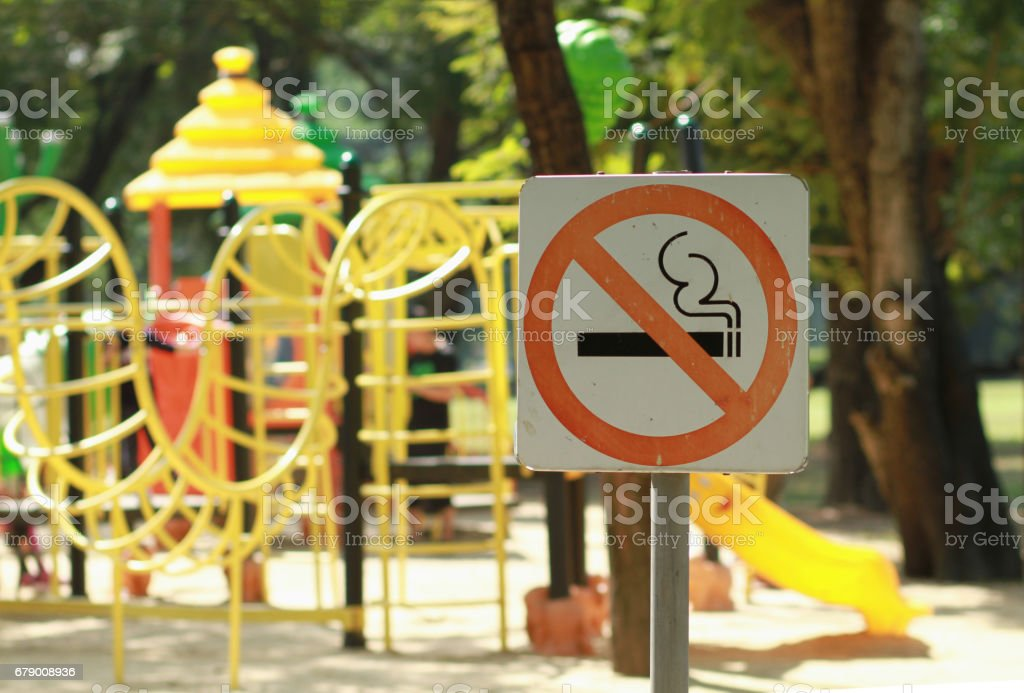 No smoking sign near children's playground in public park stock photo