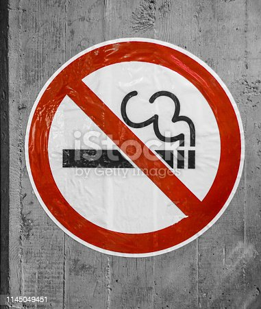 istock No Smoking Sign On a Concrete Wall 1145049451