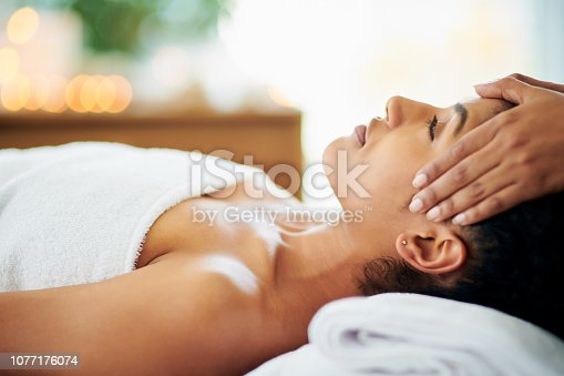 Shot of an attractive young woman getting a massage at a spa
