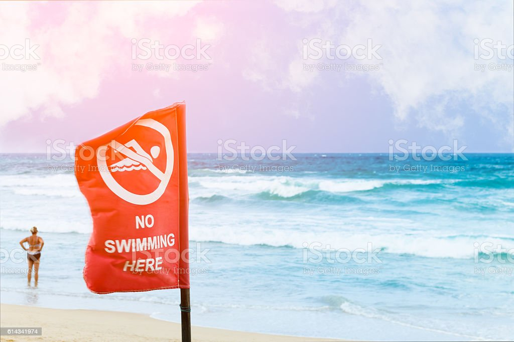 No swimming danger sign at the beach, stock photo