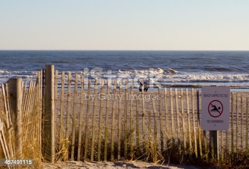 People strolling on an Atlantic City beach in the winter, with a