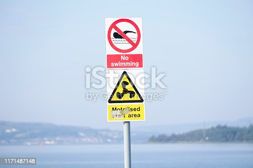 istock No swimming sign in motorised craft area at beach and sea 1171487148