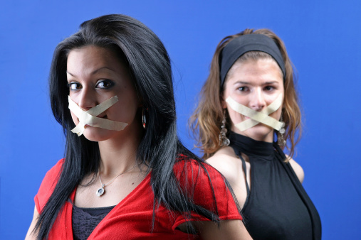 2 girls with taped mouthe
