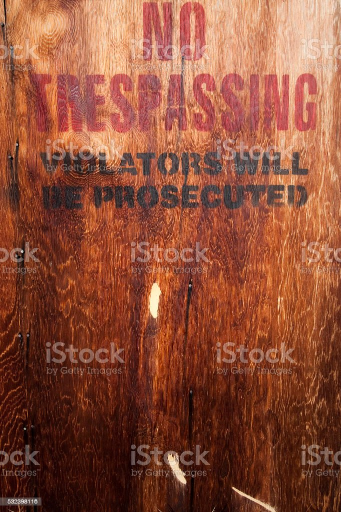 No trespassing on a wood wall stock photo
