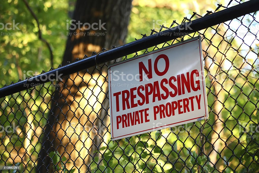 No trespassing private property sign on a fence stock photo