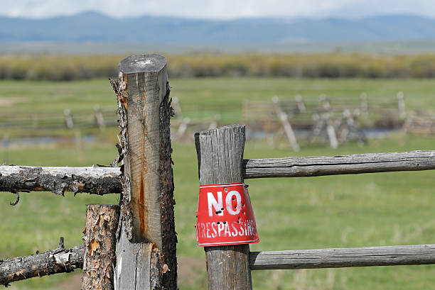 No Trespassing Sign on Gate stock photo