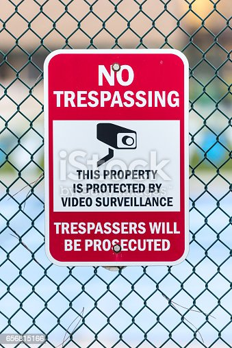 No Trespassing Sign attached to a fence