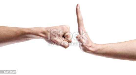 A clenched fist opposing a flat hand
